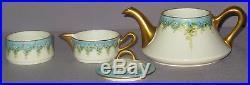 Antique'b&co.' Limoges 3-part Teapot Sugar Creamer Floral Artist Anna Drake